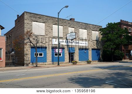 JOLIET, ILLINOIS / UNITED STATES - JUNE 30, 2015: The Joliet LithoPrint Company, Inc. offers quality printing and promotional products in downtown Joliet.