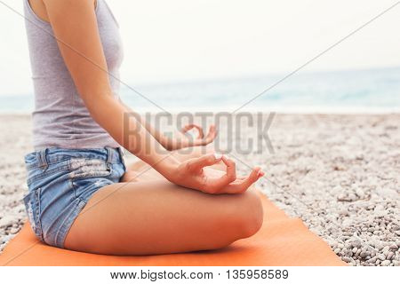 Meditating. Woman Doing Yoga. Close-up