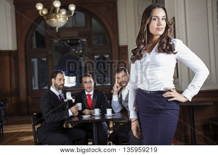 Confident Tango Dancer Standing While Pervert Men Looking At Her