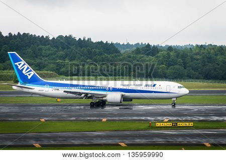 TOKYO, JAPAN - circa JUNE 2016: ANA aircraft - Boeing 767-381 - taxing at Narita International Airport. ANA, All Nippon Airways, is the largest airline in Japan.