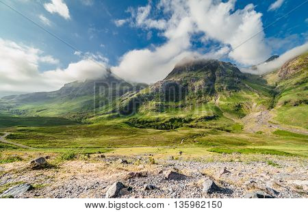 Bright Clouds Capped Summit of Glen Coe in Scottish Highlands at Spring