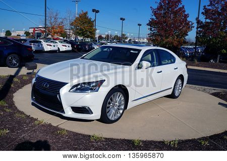 NAPERVILLE, ILLINOIS / UNITED STATES - NOVEMBER 3, 2015: A white luxury sedan is on display on the lot at Lexus of Naperville.