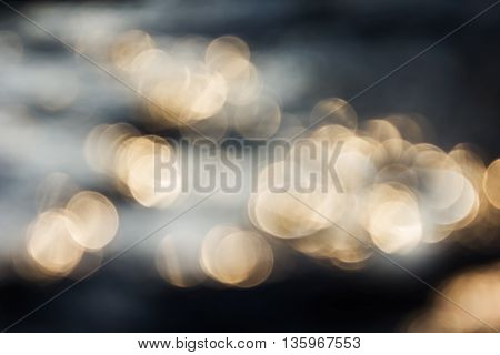 Dreamy Abstract Sparkle Shining Orange Golden Bokeh Light Crystalline Water In River Surface Romanti