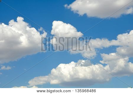 White puffy clouds in turqois blue sky