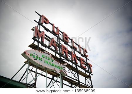 SEATTLE, WA - AUG 14: Public Market sign in downtown on August 14, 2015 in Seattle. Seattle is the largest city in both the State of Washington and the Pacific Northwest region of North America