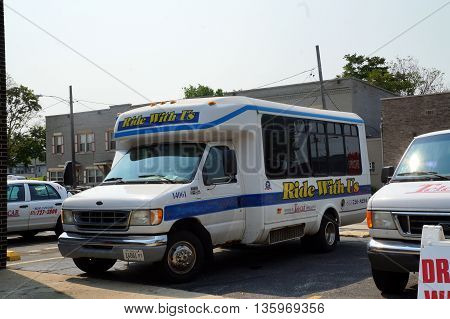 JOLIET, ILLINOIS / UNITED STATES - JUNE 30, 2015: Telecab offers a 14-passenger bus for charter and shuttle services.