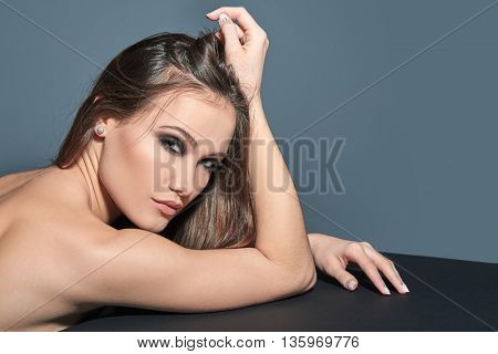 Fashionable woman. Beautiful female face. Woman of high society. Heartbreaker. Beauty woman. Portrait of amazing young fashion woman posing at studio.