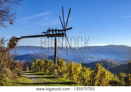 Traditional slovene scarecrow erected in vineyards in autumn