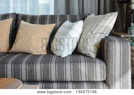 Modern Living Room Interior With Striped Pillows On A Casual Sofa At Home