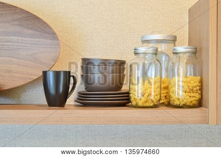Modern Ceramic Kitchenware And Utensils On Pantry Shelf