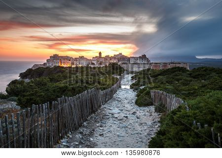 Sunset and storm over the Old Town of Bonifacio, the limestone cliff, South Coast of Corsica Island, France