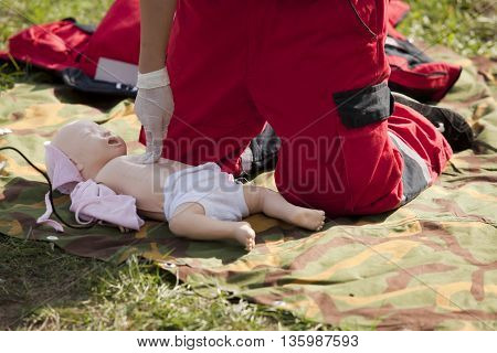 Baby CPR dummy first aid training. Cardiopulmonary resuscitation - CPR.