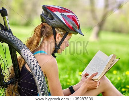 Bikes cycling girl. Girl rides bicycle. Girl in cycling read book on rest near bicycle. Cycling is good for health. Cyclist looking at camera.