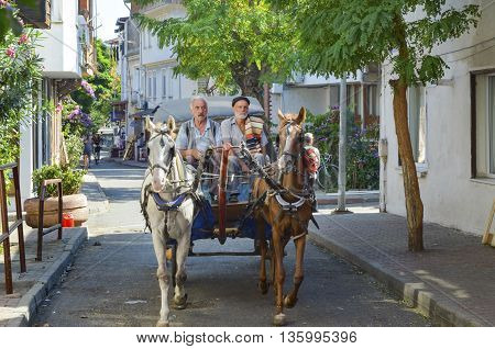 Istanbul Turkey - September 29 2013: Coachman Horse Carriage Ride. Buyukada Princes' Islands also known as Istanbul is the largest of the islands off the coast. Buyukada motor vehicle is not being used such as Phaeton carriage taxi service is.