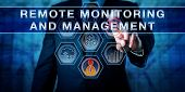 Male corporate business administrator in blue is pushing REMOTE MONITORING AND MANAGEMENT on an interactive control screen. Remote administration software concept. Industry term abbreviated as RMM. poster