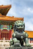 Bronze lion in front of the Hall of Supreme Harmony in Beijing Forbidden City, China poster