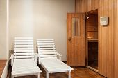 two deckchairs  of a sauna, interior poster