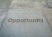 A photo of opportunity etched in the sidewalk poster