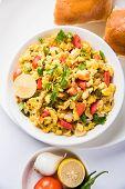Masala Anda Bhurji of egg bhurji or Spicy scrambled eggs with bread or pav or paav and salad, tasty anda bhurji paav poster