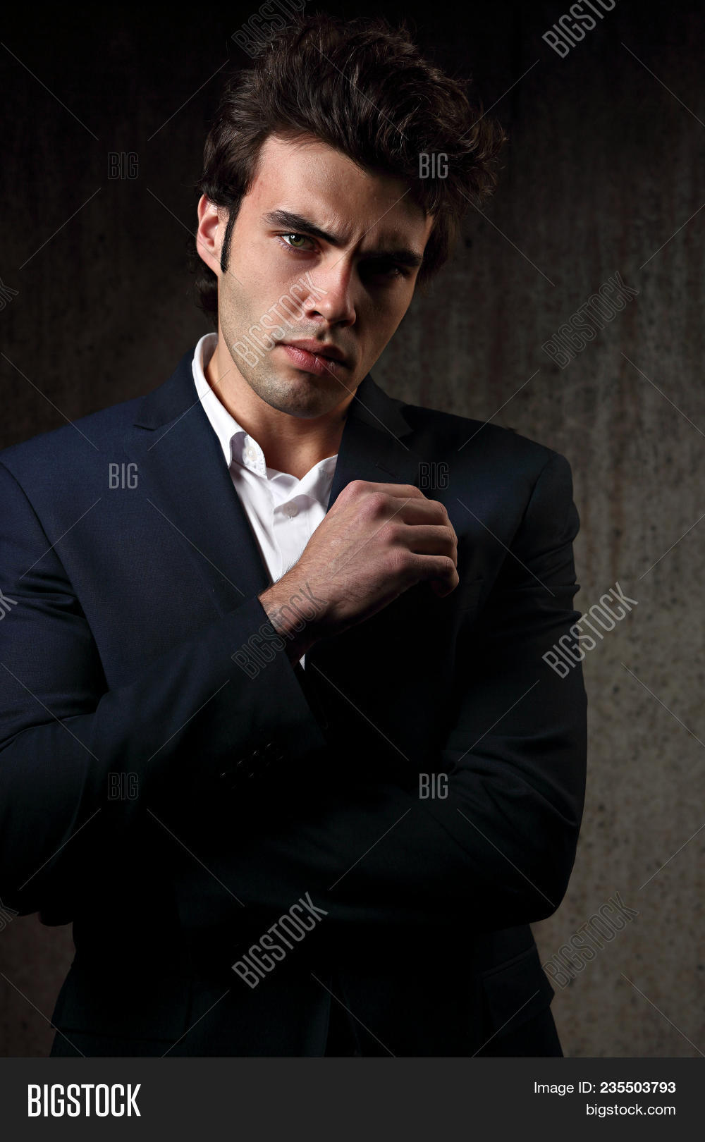 2b136930 Sexy Serious Handsome Male Model Posing In Blue Fashion Suit And White  Style Shirt On Dark