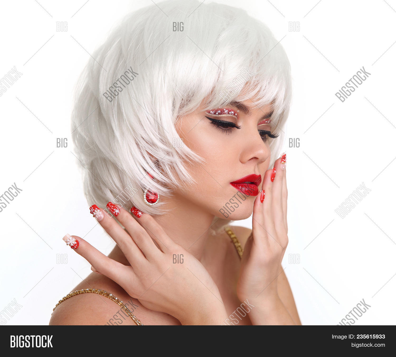 Christmas Makeup And Manicured Nails. Beautiful Blond Girl Closeup Portrait. Jewelry. White Short