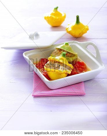 Baked Pattypan Squash Stuffed With Ground Chicken In Tomato Sauce.