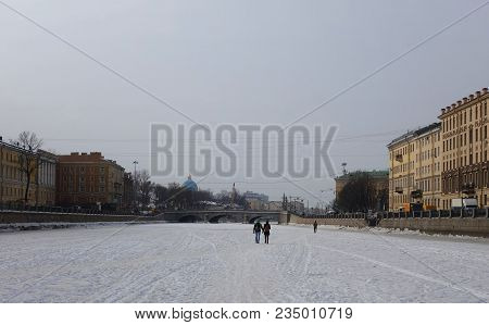 Winter Day And A Walk Along The Ice Of The Fontanka River In St. Petersburg And Obukhov Bridge