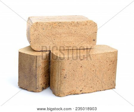 Biomass Briquettes Are A Biofuel Substitute To Coal And Charcoal. Isolated On White Background.