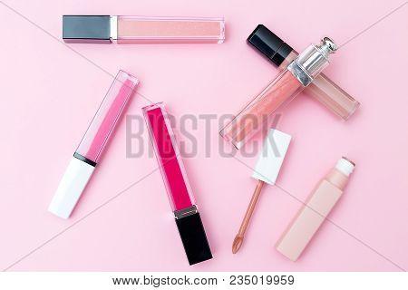 Lip Gloss On A Pink Background. Geometric Style