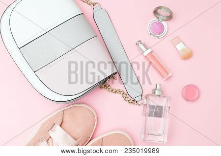 Female Accessories And Cosmetics Of Pink Color On A Pink Background. Pastel Color