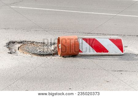 Road Damage. Damaged Street Reconstruction Or Construction Barricade Caution Red And White Sign Cove