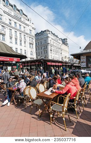 Vienna, Austria - April 7, 2018: People Shopping And Relaxing On Naschmarkt Area, Viennas Largest Ma