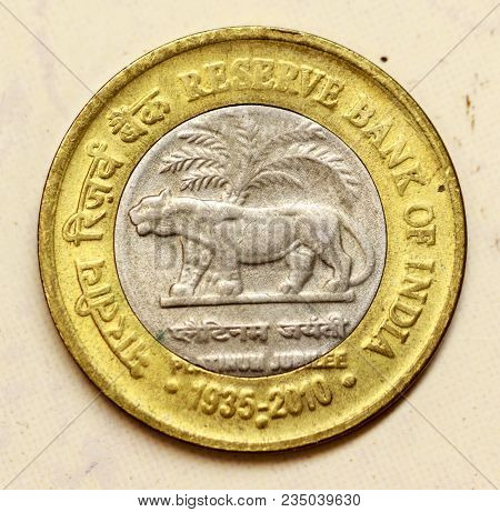 Closeup of Indian currency coin commemorating 75 years (Platinum Jubilee) of Reserve Bank of India poster