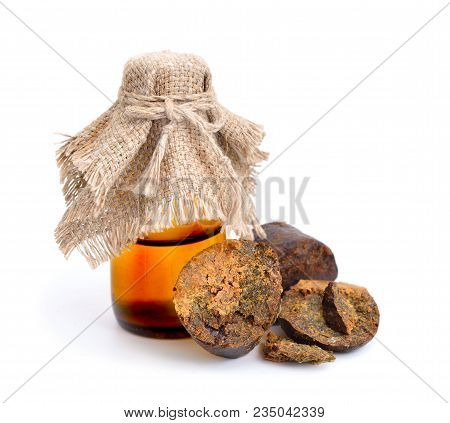Propolis Or Bee Glue With Tincture. Isolated On White Background.