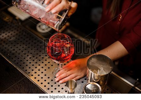 Professional Bartender Girl Pouring Thee Last Straw Of A Delicious Campari Cocktail Into The Glass