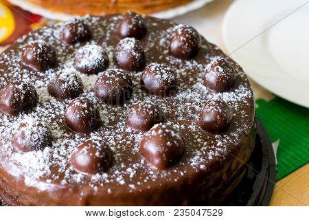 Chocolate Cherries Cream Cake. Close-up Chocolate Cake With Sugar Icing And Cherry Decoration. Choco