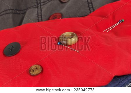 Buttons And Pins On The Background Of Synthetic Clothes Close Up