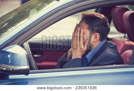 Young Man Sitting Inside His Car And Feeling Stressed And Upset