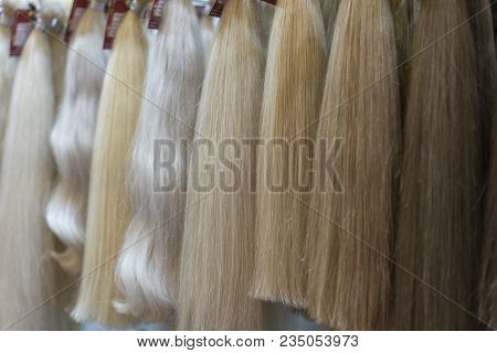 Close Up Brown, White And Another Color Of Hair Wigs Display In Beauty Salon.