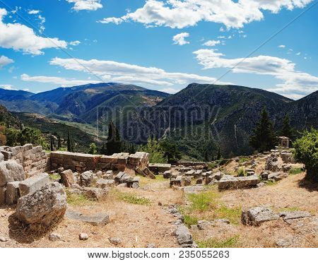 Scenic Landscape With Picturesque Mountains, Cloudy Sky And Ancient Ruins On The Hillside Of The Arc
