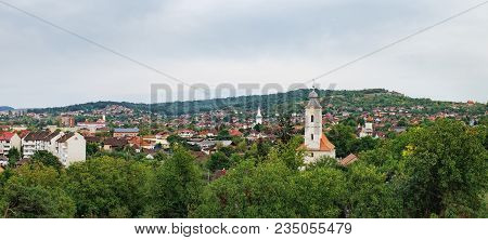 Red Roofs Of The Hunedoara City In Hunedoara County In Transylvania, Romania, Where The Corvin Castl