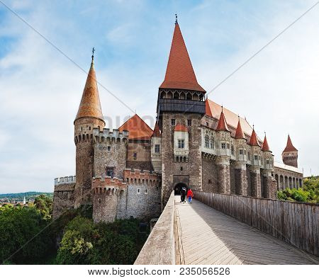 Wooden Bridge Across The Moat To The Main Gate To The Corvin Castle, Which Also Known As Castelul Co