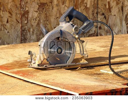 A Circular Saw Sitting Idle And Unused At A Construction Site.