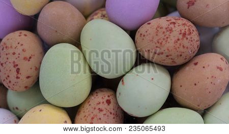 Colorful Sugar Coated Speckled Chocolate Eggs In A Range Of Colors Including Pink, Yellow And Green.