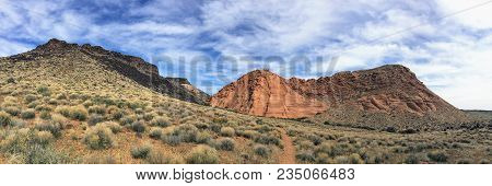 Views Of Sandstone And Lava Rock Mountains And Desert Plants Around The Red Cliffs National Conserva