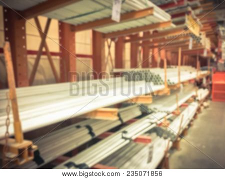 Blurred Stack Of Plain End Pipes At Hardware Store In Usa