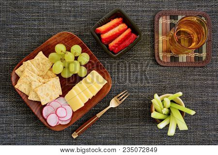 Smoked Salmon, Sharp Cheese, Wheat Crackers, Grapes. Celery Sticks And Radish Slices On Wooden Plate