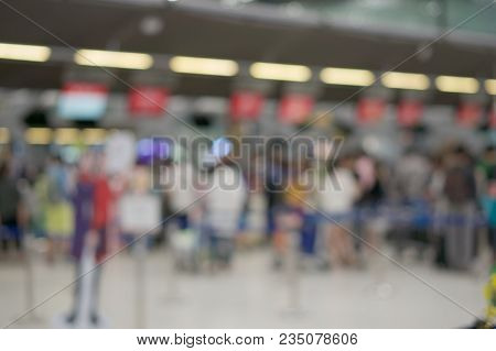 Abstract Blurred Passenger Waiting For Check In At Airport Terminal