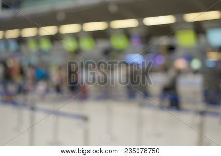 Abstract Blurred Traveler Waiting For Check In At Airport Terminal
