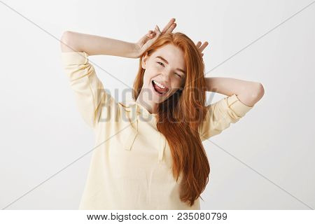 Shake Up World With Happiness. Portrait Of Expressive Playful Redhead Girlfriend Tilting And Holding